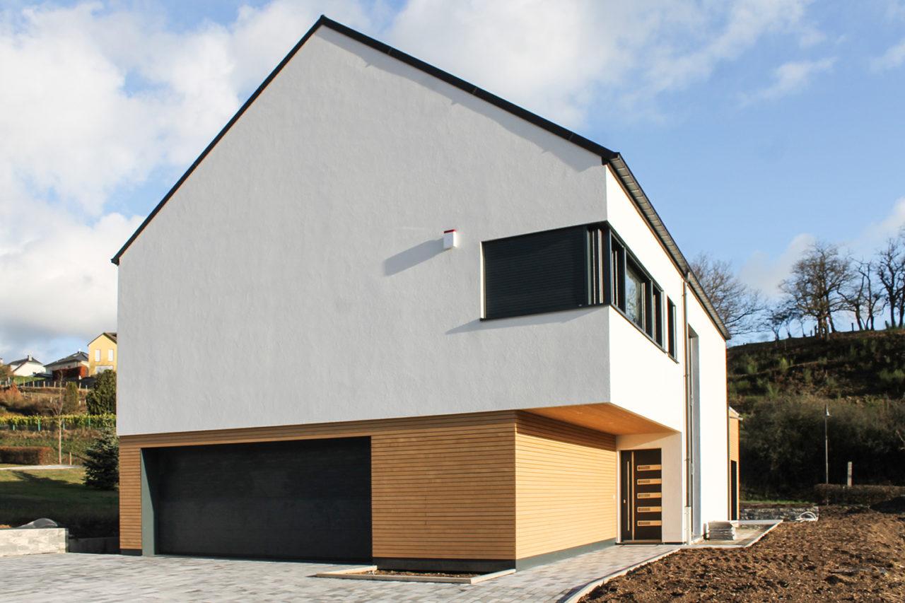 Neubau Putzfassade Holzfassade – Dura Sidings